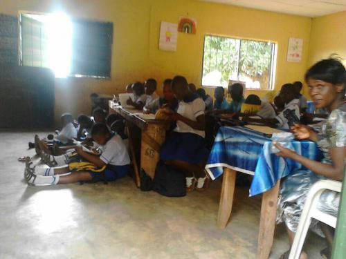 School Children Sitting On The Floor And Studying In The Dilapidated School Building/Classrooms